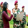 Cricketer M.S. Dhoni looks at the army jawans' training