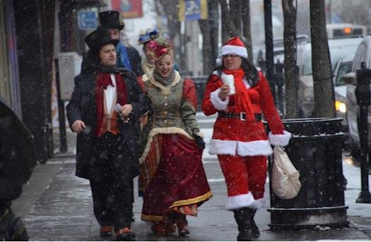 Caroler on Broadway in Bayonne on Dec. 15, 2013.